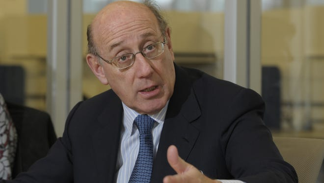 Kenneth Feinberg is representing Penn State in settlement talks with abuse victims in the case involving former coach Jerry Sandusky.