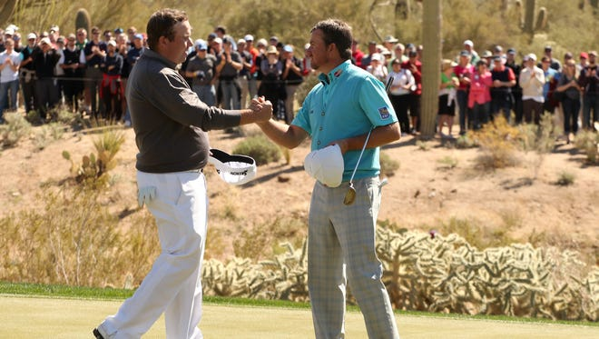 Shane Lowry of Ireland congratulates Graeme McDowell of Northern Ireland after McDowell won their match 3 and 2.
