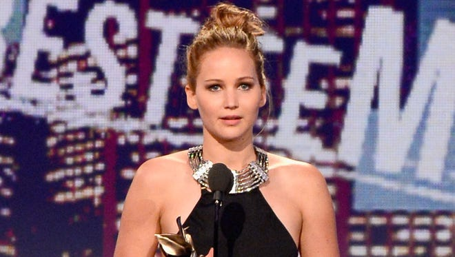 Jennifer Lawrence accepts the award for best female lead during the Film Independent Spirit Awards.