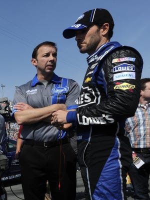 Jimmie Johnson, right, talks with crew chief Chad Knaus before Thursday's Budweiser Duel race one at Daytona International Speedway.