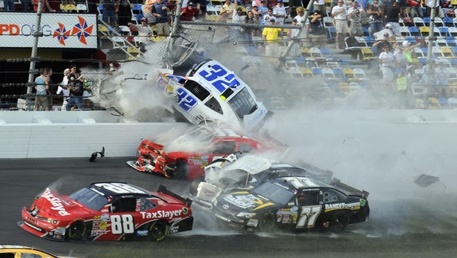 Kyle Larson (32) goes up into the fence during a scary last-lap crash in Saturday's Nationwide race at Daytona International Speedway.