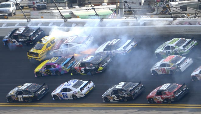 Michael Annett (43), Johanna Long (70), Travis Pastrana (60), Hal Martin (44) and Kasey Kahne (5) collide between Turns 1 and 2.