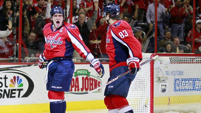 Washington Capitals winger Alex Ovechkin (8) celebrates with center Jay Beagle after scoring a goal against the New Jersey Devils in the third period.