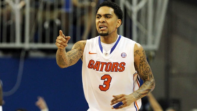 Florida Gators guard Mike Rosario reacts after he made a three pointer against the Arkansas Razorbacks during the first half at the Stephen C. O'Connell Center.