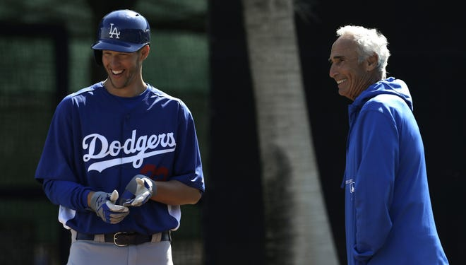 From on Cy Young Award winner to another, Sandy Koufax, right, talks with Clayton Kershaw at Dodgers camp.