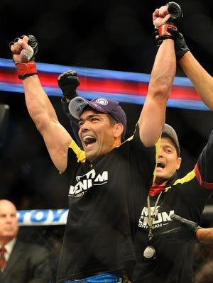Lyoto Machida celebrates his unpopular split-decision win over Dan Henderson.