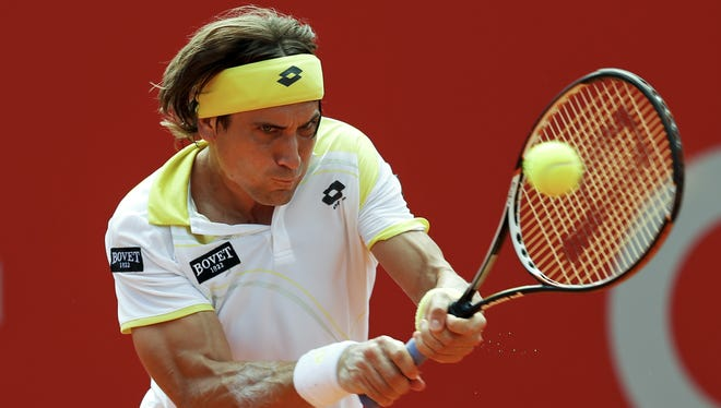 David Ferrer of Spain muscles a backhand during his victory Sunday against Stanislas Wawrinka of Switzerland.