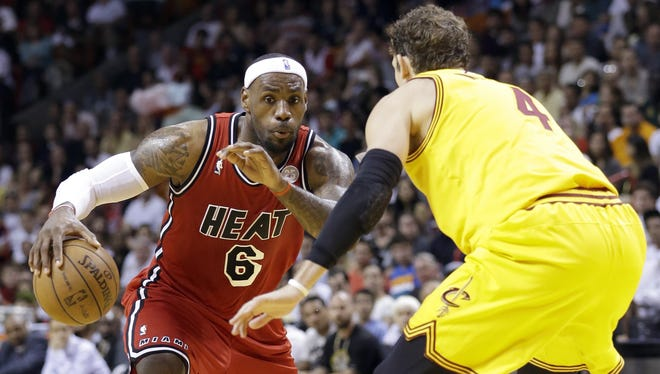 Miami Heat forward LeBron James (6) drives to the basket against Cleveland Cavaliers forward Luke Walton (4) during the first half of an NBA basketball game, Sunday, Feb. 24, 2013, in Miami.