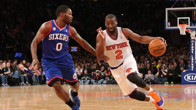 New York Knicks point guard Raymond Felton (2) drives around Philadelphia 76ers point guard Jeremy Pargo (0) during the fourth quarter at Madison Square Garden.