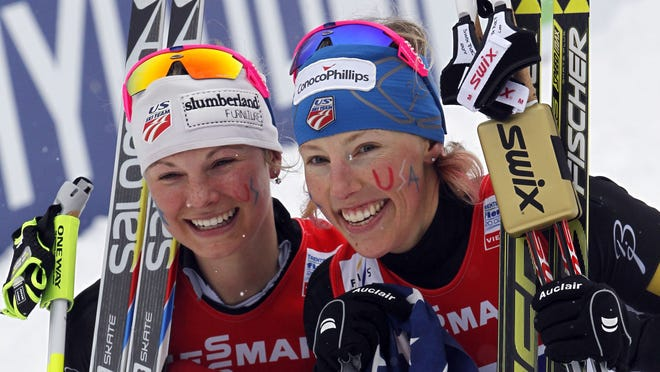 Jessica Diggins and Kikkan Randall of the United States take gold during the FIS Nordic World Ski Championships Cross Country Women's Team Sprint on February 24, 2013 in Val di Fiemme, Italy.