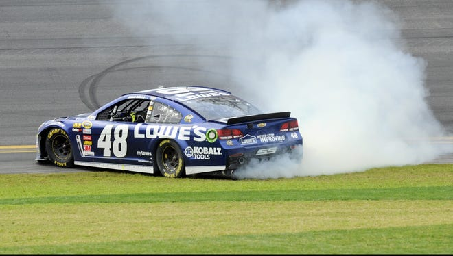 NASCAR Sprint Cup Series driver Jimmie Johnson does a burnout after winning the Daytona 500.