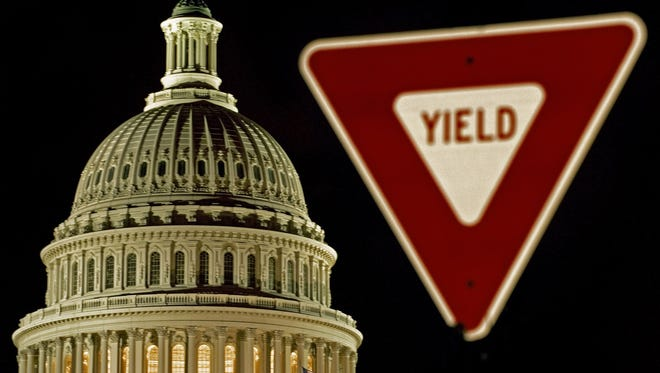 """A traffic sign reads """"yield"""" outside the Capitol dome in Washington, D.C. Yielding or compromising is not something many Americans associate with Washington."""