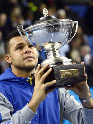 Jo-Wilfried Tsonga of France holds his trophy after defeating Tomas Berdych of the Czech Republic on Sunday in the Open 13 final in Marseille, France.
