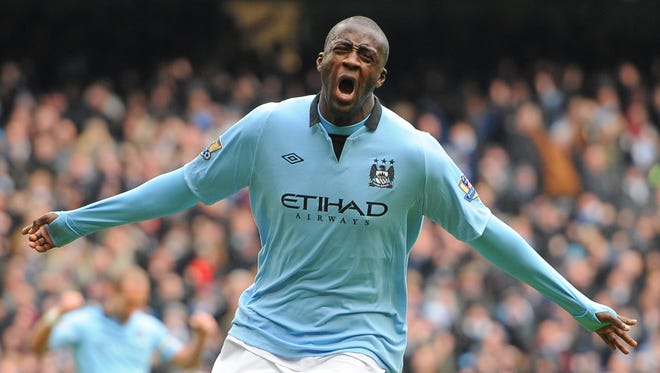 Manchester City's midfielder Yaya Toure celebrates scoring the opening goal of the English Premier League match between Manchester City and Chelsea at the Etihad Stadium in Manchester, northwest England, on Sunday.