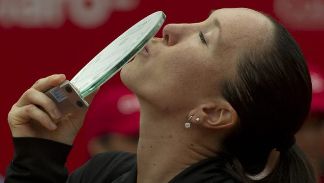 Jelena Jankovic of Serbia kisses the trophy in Bogota, Colombia, after defeating Paula Ormachea of Argentina.