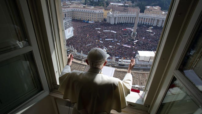 Pope Benedict leads the Angelus prayer from the window of his apartment at the Vatican
