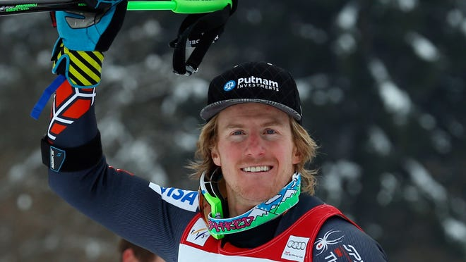Ted Ligety, of the United States, celebrates after finishing third in a men's World Cup giant slalom in Garmisch-Partenkirchen, Germany, Sunday.