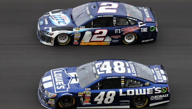 Brad Keselowski (2) battles Jimmie Johnson (48) for the lead during the latter stages of Sunday's Daytona 500.