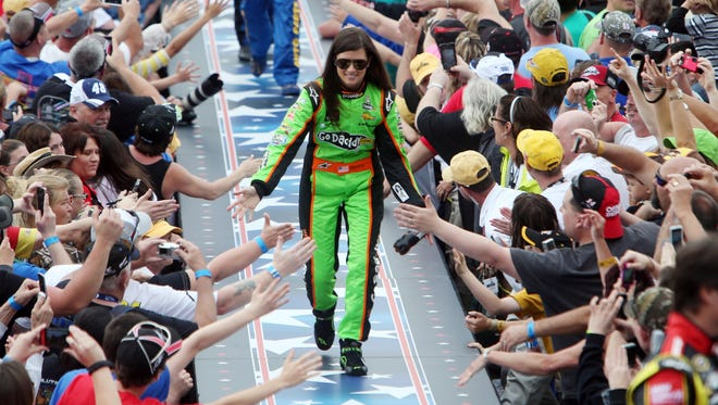 Danica Patrick greets fans as she is introduced before the 2013 Daytona 500 on Sunday.