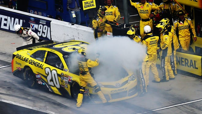 Matt Kenseth, driver of the No. 20 Dollar General Toyota, pits after his car started to smoke during the Daytona 500.