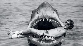 Steven Spielberg goofs off with the shark from 'Jaws.'