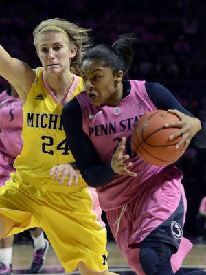Penn State's Alex Bentley drives against Michigan's Jenny Ryan during the first half of in State College, Pa., Sunday, Feb. 24, 2013.