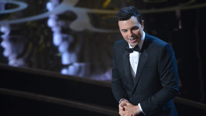 Host Seth MacFarlane gets to work on Sunday during the Academy Awards show at the Dolby Theatre in Hollywood.