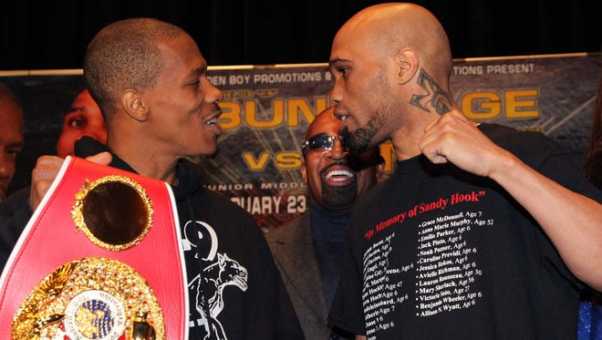 Cornelius Bundrage, left, and Ishe Smith during their final press conference. Smith dethroned Bundrage with a split decision victory Saturday night in Detroit.