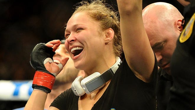 Ronda Rousey celebrates her victory over Liz Carmouche after their UFC women's world bantamweight championship bout at the Honda Center.