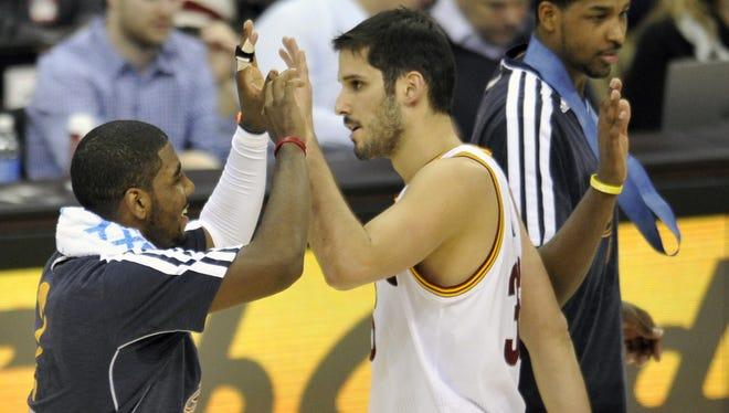 Cavaliers forward Omri Casspi high-fives point guard Kyrie Irving on Jan. 9.