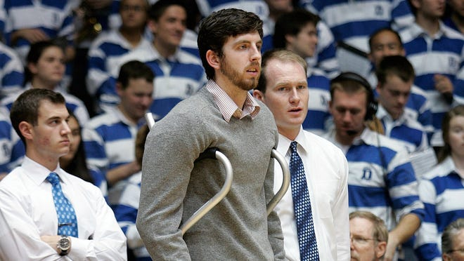 Duke Blue Devils injured forward Ryan Kelly watches his team warm up before their game against the Georgia Tech Yellow Jackets at Cameron Indoor Stadium.