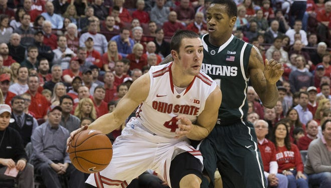 Ohio State's Aaron Craft, turning the corner on a drive against Michigan State's Keith Appling, more than doubled his season scoring average with a 21-point performance Sunday.