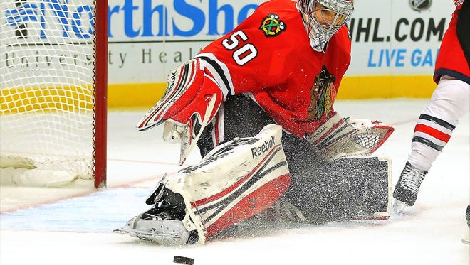 Chicago Blackhawks goalie Corey Crawford makes a pad save during the third period against the Columbus Blue Jackets at the United Center.