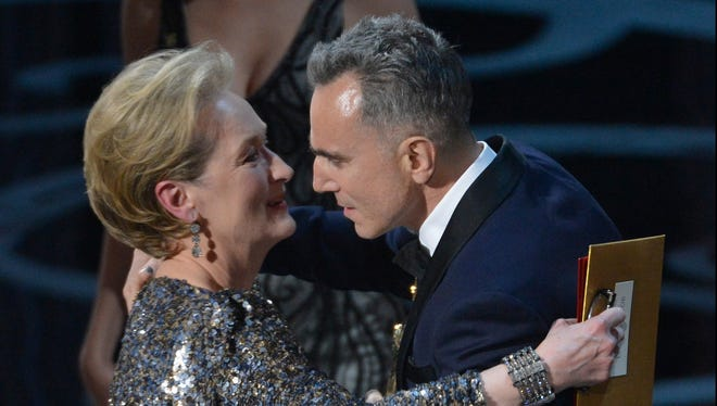 Meryl Streep hugs Daniel Day-Lewis after he won the Oscar for best actor.