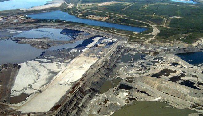 An aerial photo of the Syncrude Canada oil sands mine north of Fort McMurray, Alberta.