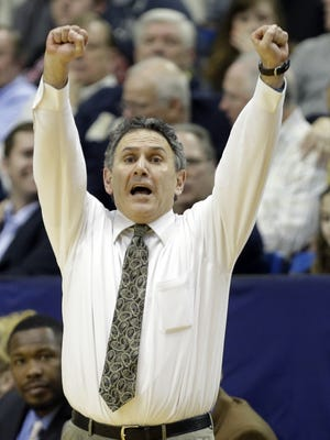 Akron coach Keith Dambrot yells to his players in a game earlier this season. With the nation's longest winning streak, a dominant center with NBA potential, the fiery Dambrot and LeBron James as a supporter, Akron could become the next mid-major to make a deep run in the NCAA tournament.