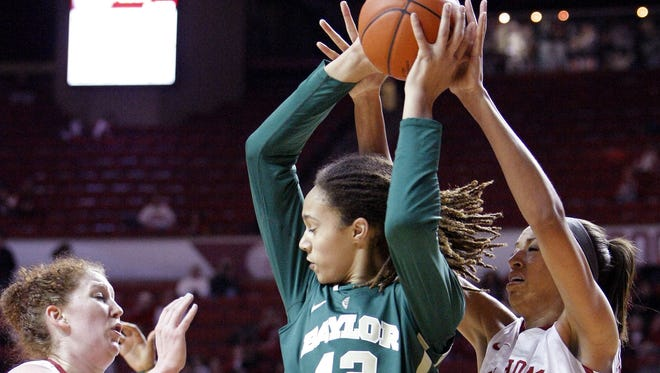 Oklahoma's Joanna McFarland (53) and Nicole Griffin (4) defend as Baylor forward Brittney Griner (42) looks to pass during the first half of a NCAA Women's basketball game in Norman, Monday, Feb. 25, 2013.