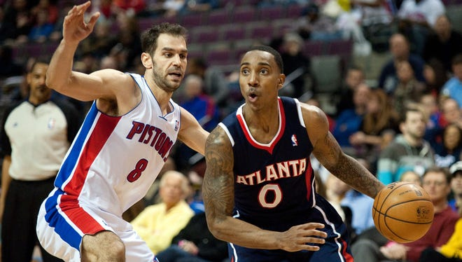 Atlanta Hawks point guard Jeff Teague (0) drives to the basket while being pressured by Detroit Pistons point guard Jose Calderon (8) during the second quarter at The Palace.