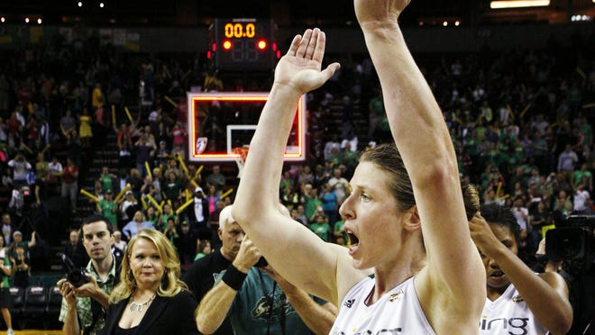Seattle Storm's Katie Smith celebrates their 86-79 win over the Minnesota Lynx after the second overtime period of Game 2 of a WNBA basketball first-round playoff series, Sunday, Sept. 30, 2012, in Seattle.