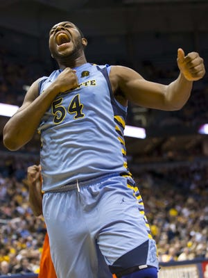 Marquette Golden Eagles forward Davante Gardner (54) celebrates a play during the first half against the Syracuse Orange at the BMO Harris Bradley Center.