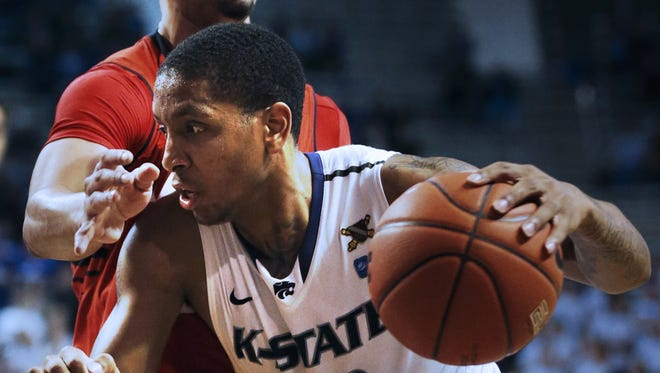 Kansas State guard Rodney McGruder (22) drives against Texas Tech guard Ty Nurse (4) during the second half of an NCAA college basketball game in Manhattan, Kan., Monday, Feb. 25, 2013.