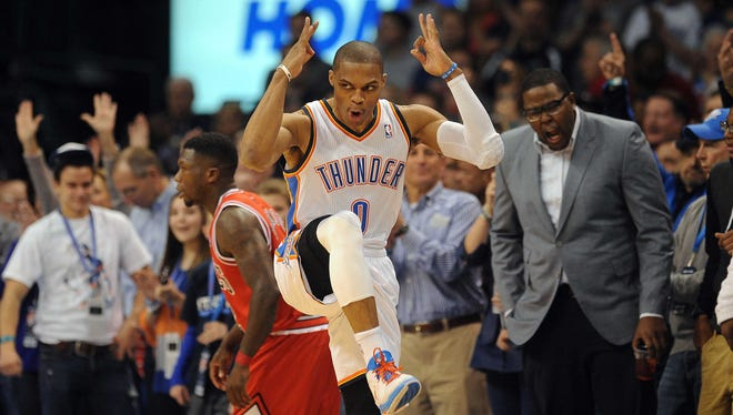 Oklahoma City Thunder guard Russell Westbrook (0) celebrates after a made 3 point attempt against the Chicago Bulls during the first half at Chesapeake Energy Arena.