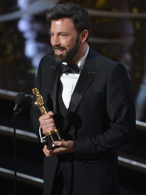 """Ben Affleck on stage with the Oscar after """"Argo"""" won Best Picture."""