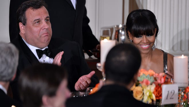 First lady Michelle Obama and New Jersey Gov. Chris Christie listen as President Obama speaks during the 2013 Governor's Dinner at the White House on Sunday.