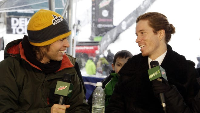 "Kevin Pearce (left) and Shaun White joke during a television interview for the Dew Tour at Breckenridge ski resort in Breckenridge, Colo., on Dec. 14, 2012. In a documentary, ""The Crash Reel,"" Pearce talks about his recovery from a traumatic brain injury. He says he has suffered six or seven concussions in his career."