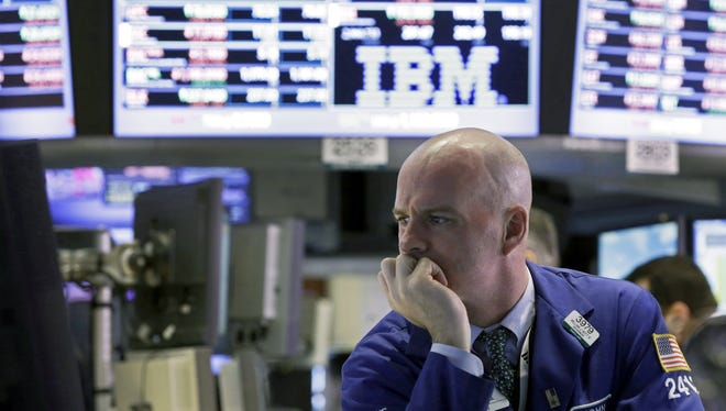 Specialist John O'Hara works at his post on the floor of the New York Stock Exchange Monday, Feb. 25, 2013.