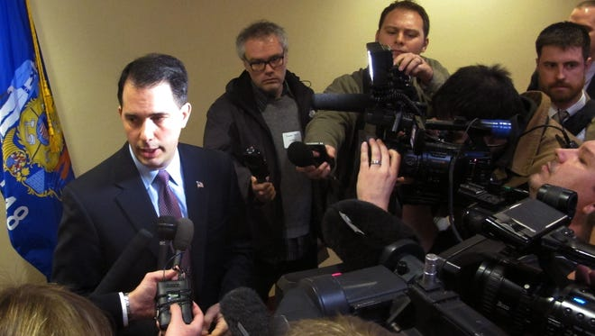 Gov. Scott Walker takes questions after announcing Wisconsin will not be expanding Medicaid services as allowed under the federal health care law on Wednesday, Feb. 13, 2013.