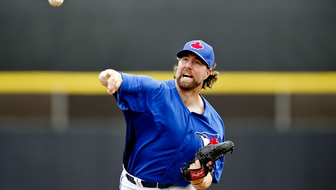 R.A. Dickey gave up two runs and four hits over two innings in his Blue Jays debut.