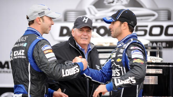 Jimmie Johnson is congratulated by crew chief Chad Knaus, left, and owner Rick Hendrick, center, after winning the 2013 Daytona 500 on Sunday.