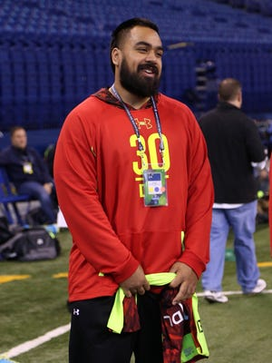 Utah Utes defensive lineman Star Lotulelei, who has a heart medical condition, sits out the workouts and watches from the sidelines during the NFL combine Monday in Indianapolis.